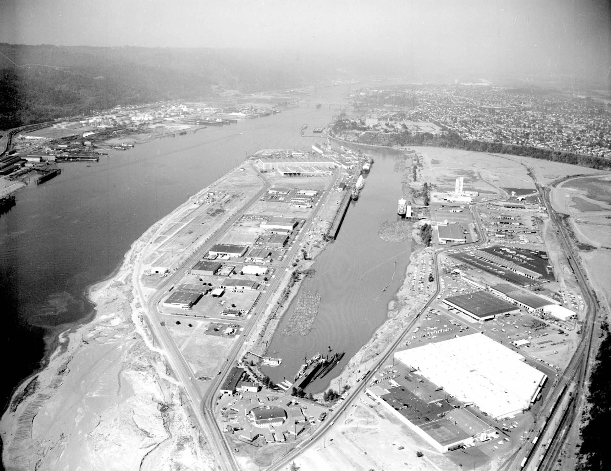 Swan Island workers followed the pattern of other coast yards by reducing the construction time on its ships each year. In the average Swan tanker was built in days, but in that time was cut to days, an improvement of about 45 per cent.