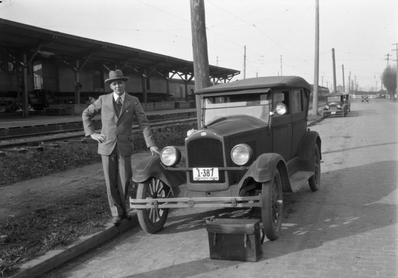 A2009-009.1204 Man Posing with Car NW 14th & Lovejoy 1928