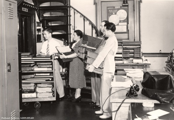 Employees Loading Files into Elevator, Aug. 8, 1940 : A2009-009.420