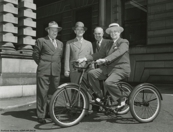 Mayor Earl Riley and city officials posing with tricycle outside City Hall, circa 1948 : A2005-005.261.21