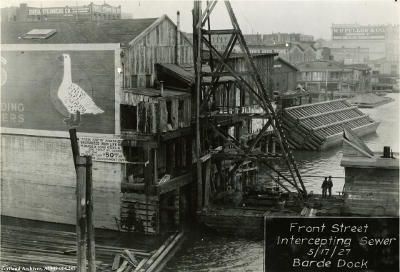 Front Ave Sewer Barde Dock showing the crane used in the construction, May 17, 1927 : A1999-004.245