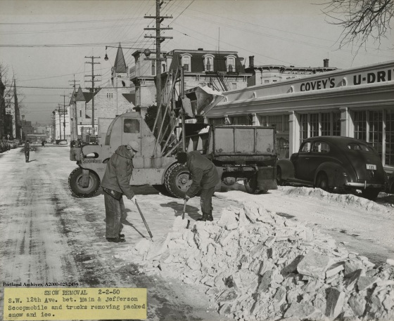 Crew by trucks and scoopmobile for snow removal on SW 12th Ave. between Main and Jefferson St., Feb. 2, 1950: A2000-025.2459