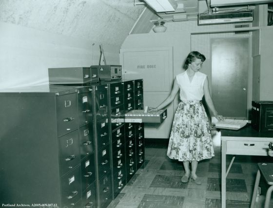 Auditor's microfilm operation in City Hall, 1954: A2005-005.387.12