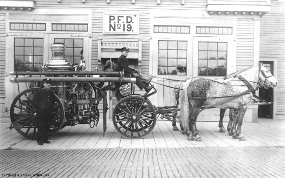 Crew and horse drawn apparatus pose outside station, circa 1910: A2001-083