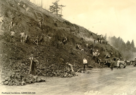Men grading hill and loading trucks and sorting rock piles for fills on SW 4th Street, 025.520