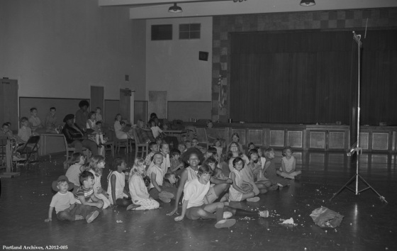Children watching a film in an auditorium, August 4, 1970: A2012-005
