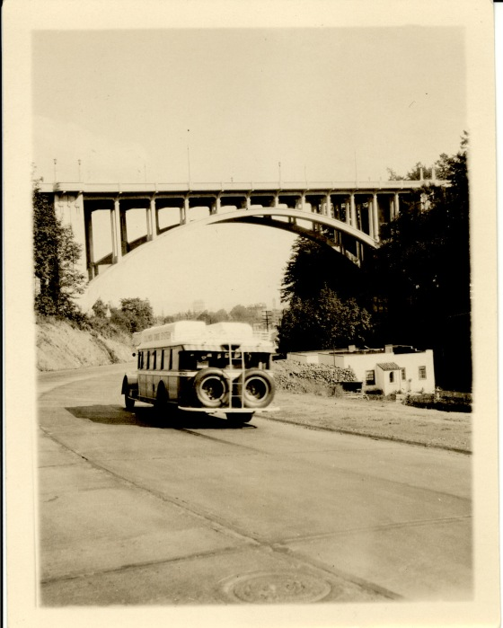 A bus heading west on the recently paved Canyon Road toward the Vista Avenue Viaduct, 1930
