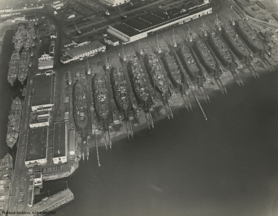 Aerial view of Oregon Shipyards and ship production, circa 1943: A2004-002.6713