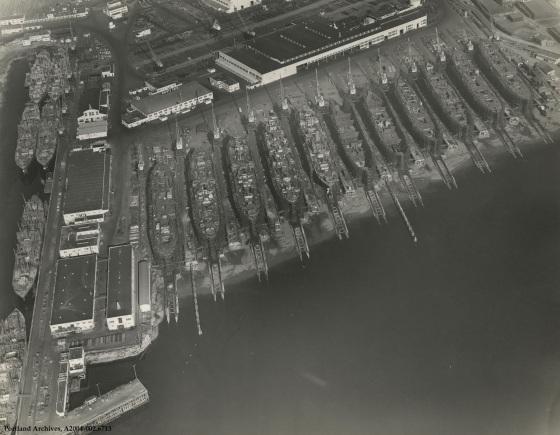 Aerial view of Oregon Shipyards and ship production, circa 1943: A2004-002.6713