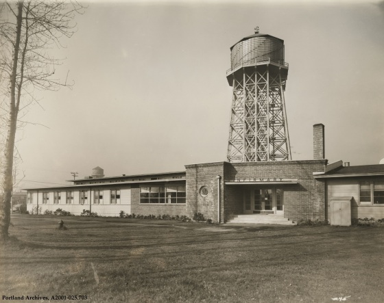 View of Vanport hospital office entrance looking west with view of water towers no. 4 and 5, circa 1944: A2001-025.703