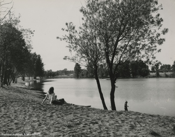 Woman and two children at Force Lake shoreline, 1944: A2001-025.672