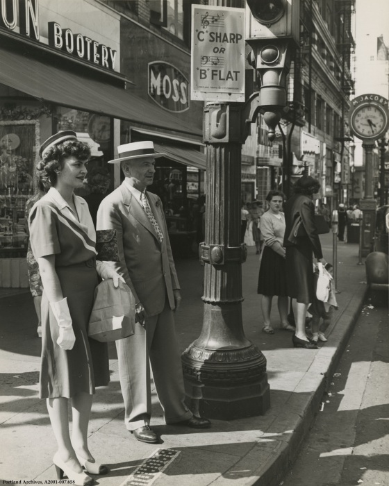 Traffic engineering  Commissioner Bowes standing on SW Broadway below a Traffic Safety Commission sign reading C Sharp or B Flat, June 30, 1948: A2001-007.658