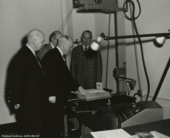 Mayor Fred L. Peterson micro-photographing the first document in the City's microfilm program, 1955: A2011-004.167