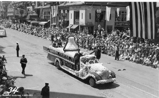 Truck 5 and crew in the Rose Festival Parade on SW Broadway, 1938: