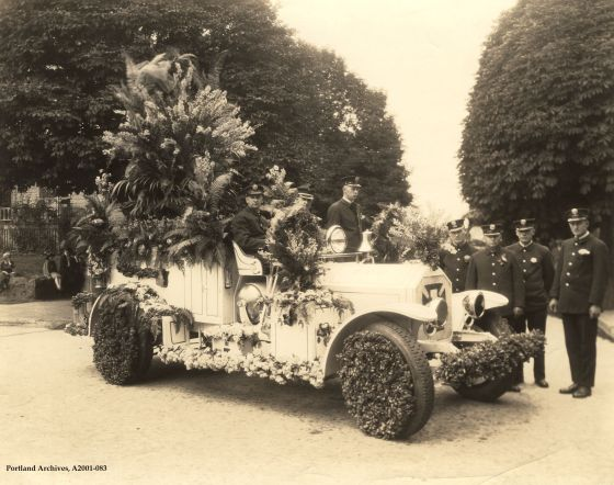 Crew pose with Squad 1 car, decorated for Rose Festival Parade, circa 1926: A2001-083