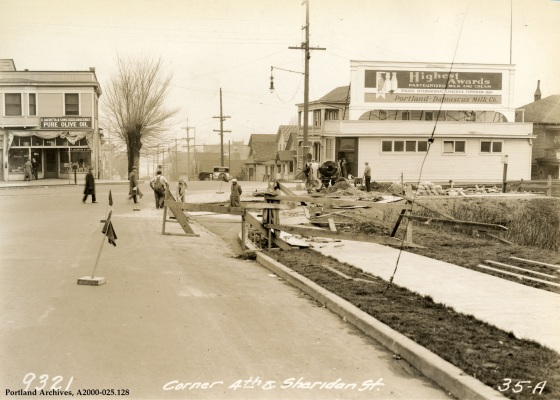 Men cutting corners at corner of SW 4th Avenue and SW Sheridan Street, 1931: A2000-025.128