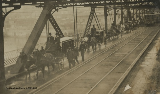 City of Portland Archives, Oregon, funeral procession across the Morrison Bridge, A2001-083, circa 1910.